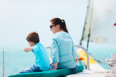 Family sailing on luxury yacht. Mother and son relaxing while sailing on luxury yacht Stock Images