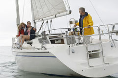 Family Sailing On Boat During Vacations Royalty Free Stock Photos