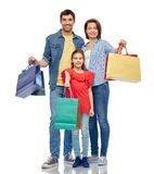Happy family with shopping bags. Family, sale and people concept - happy smiling mother, father and little daughter with shopping bags over white background stock image