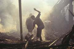 Family salvaging possessions after riots,