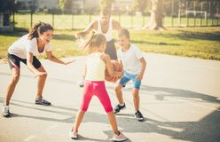 Family in the same team. Family playing basketball together royalty free stock photos