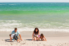 Family on the sand Royalty Free Stock Image
