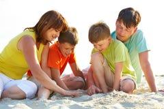 Family on sand Royalty Free Stock Photo