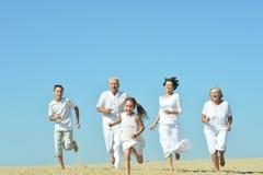 Family on sand beach Stock Photos
