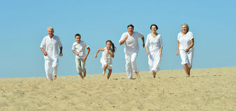 Family on sand beach Royalty Free Stock Image