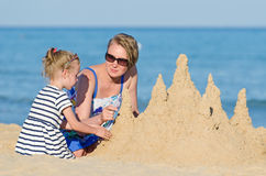 Family with sand castle Royalty Free Stock Photos