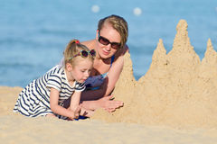 Family with sand castle Stock Image