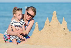 Family with sand castle Royalty Free Stock Photo