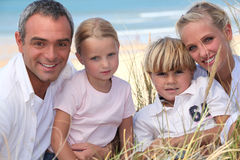 Family in the sand dunes Royalty Free Stock Photo