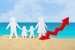 Family on the sand near the sea and arrow graphics up. The concept of growing tourists in the summer tourist season. Family from dad, mom, son and daughter on Stock Images