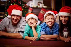 Family in Santa caps Royalty Free Stock Photography