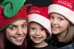 Family in Santa Claus hats Royalty Free Stock Photo