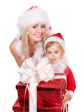 Family in Santa Clause costume giving  gift box. Royalty Free Stock Photography
