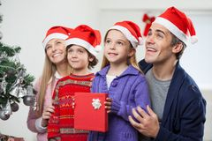 Family In Santa Hat With Christmas Present Royalty Free Stock Images