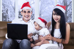 Family with santa hat and laptop Royalty Free Stock Photo
