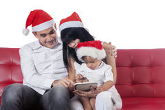 Family with santa hat using tablet Royalty Free Stock Images