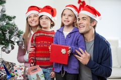Family In Santa Hats With Christmas Gift Royalty Free Stock Images
