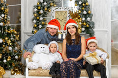 Family in santa hats and gift boxes Royalty Free Stock Image