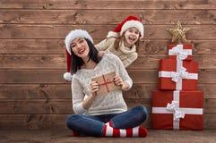 Family in Santa hats Royalty Free Stock Photography