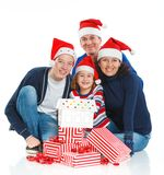 Family in Santa's hat with gift box Stock Photo