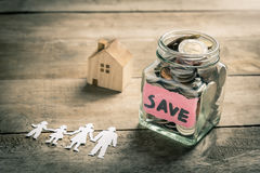 Family saving money for buying house Royalty Free Stock Photos