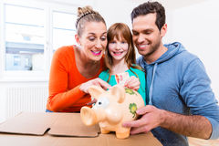Family saving money by moving house Royalty Free Stock Photography