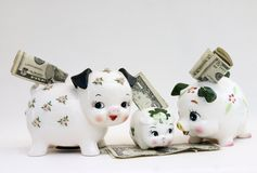 Family Savings. Cute family of piggy banks Stock Photo