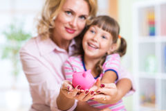 Family and savings concept - happy mother and Stock Image