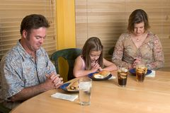 Family Saying Grace 1. A family saying grace over their lunchtime meal Royalty Free Stock Photo