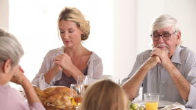 Family saying grace before dinner Royalty Free Stock Photography