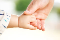 Family scene , closeup parent and baby holding hand together Royalty Free Stock Photos