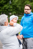 Family scene with grandmother holding her grandson in her arms Royalty Free Stock Photography