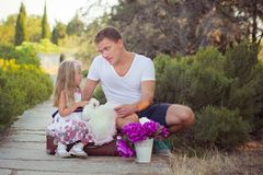 Family scene handsome young dad father posing playing with his baby daughter in central park forest summer meadow Happy life time Royalty Free Stock Photography