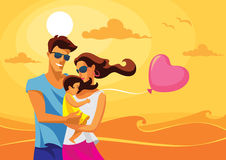 Family by the sea. Happy family standing by the sea on a sunny day Stock Photo