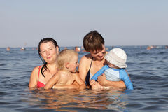 Family in the sea Stock Photo
