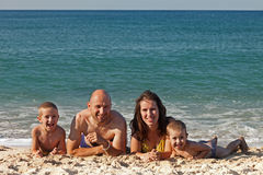 Family on sea beach Stock Images