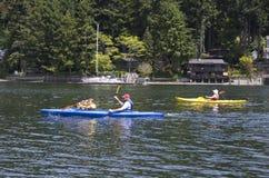 Family sea kayaking Stock Photo