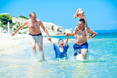 Family sea run fun vacation Royalty Free Stock Image
