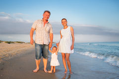 Family on the sea. Family walking by the sea stock photography