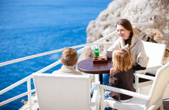 Family at seafront cafe Stock Images