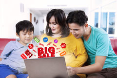 Family searching big sale promotion Stock Image