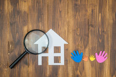 Family Searching house conceptual, paper house with Magnifier Royalty Free Stock Image