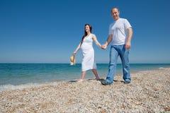 Family on seashore Stock Photography