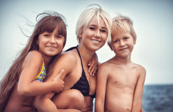 Family on the seashore Royalty Free Stock Image