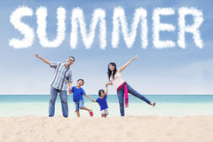 Family at seaside under a summer text Stock Photo