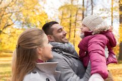 Happy family at autumn park Stock Images