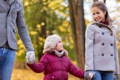 Happy family walking at autumn park Royalty Free Stock Photo