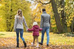 Happy family walking at autumn park Royalty Free Stock Photography