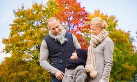 Happy family over autumn park background stock photos