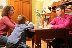 Family seats behind table Royalty Free Stock Image